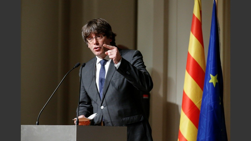 Former Catalan leader Carles Puigdemont gestures during a meeting with Catalan mayors in Brussels